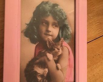 Vintage girl blue hair and kitten in pink frame