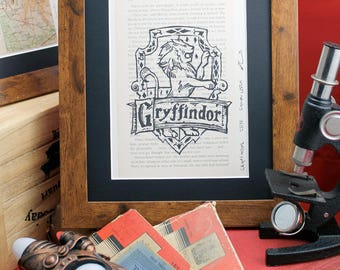 Gryffindor linocut on upcycled Harry Potter book. Limited edition Order of the Phoenix lino print inc.  Hufflepuff, Ravenclaw & Slytherin