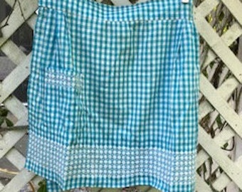 Turquoise gingham vintage half apron. Beautiful color and trim.