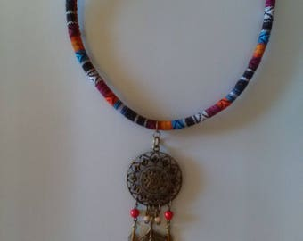 Ethnic necklace feathers beads and metal