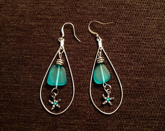 Blue sea glass tear drop earrings with starfish pendant