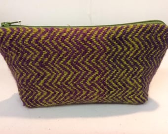 Medium sized zipped purse with handwoven front panel in alpaca.
