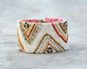 Textile cuff. Light linen / cotton chevron cuff / bracelet with woolen embroidery and brass embellishments ( size M/L)