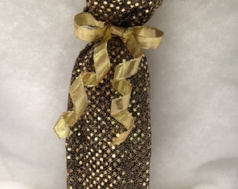 Set of two (2) gold and black sparkly wine bags with gold ribbon. Fully lined.