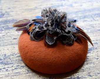 A Stunning Burnt Orange Felt Fascinator with Feather Flower Detail the Perfect Vintage inspired headpiece
