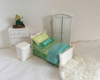 One Twin Bed with two looks (reversible bedding) in shades of Blue, Green and White available in four frame colors for 1:12 Scale Dollhouse