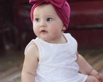 Turban Double bow in a Suede fabric .