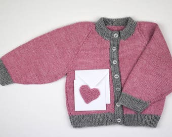 Vintage style hand knitted baby girl cardigan in pink and grey. Matching gift card