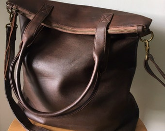 Genuine lambskin leather, shoulder tote bag.Our Traveller bag is so unique.Long strap and stitched handles the perfect,lined shoulder bag
