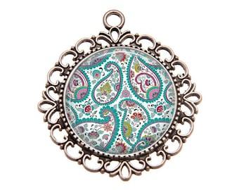 Silver Pendant, resin cabochon, blue Paisley design