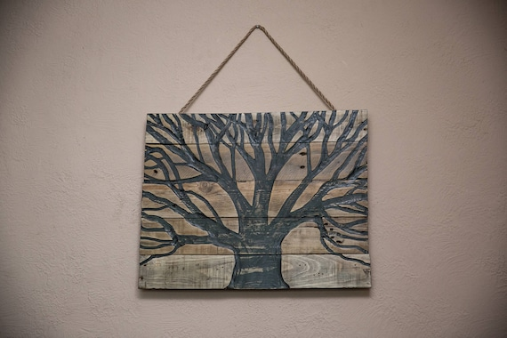 Pallet wood wall art with a tree carved into it pallet wood tree home decor reclaimed wood art pallet wood art wood carvings tree art