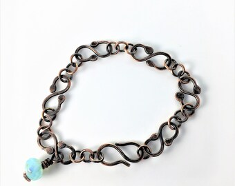 copper bracelet with patina