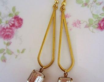 Rhinestone earrings. Long dangle earrings. Art deco earrings. Clear rhinestone earrings. Brass earrings. Long gold earrings. Mod earrings.