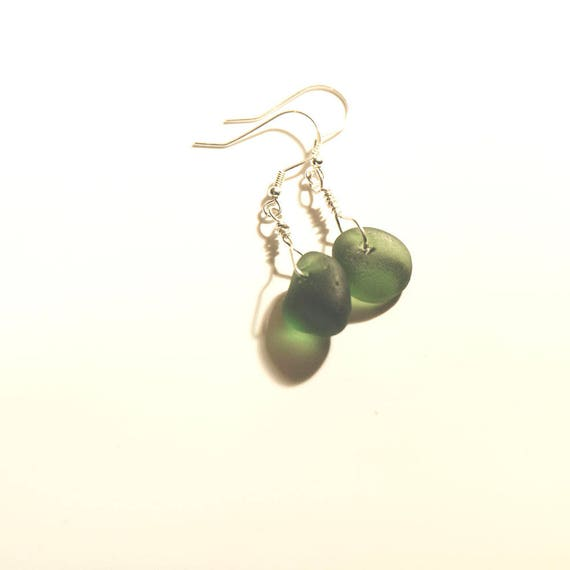 Green Seaham seaglass earrings wrapped in sterling silver wire on sterling silver hooks.