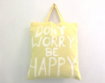 Don't Worry be Happy yellow medium cotton handheld tote