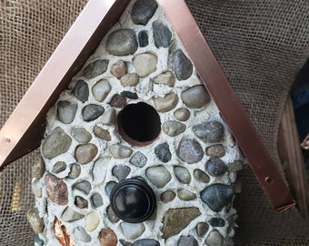 A one of a kind, stone birdhouse, copper clad roof. Easy clean out. Made in Michigan