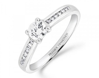 Stunning round brilliant cut four claw solitaire diamond engagement ring, with channel set diamond shoulders 0.55 carat