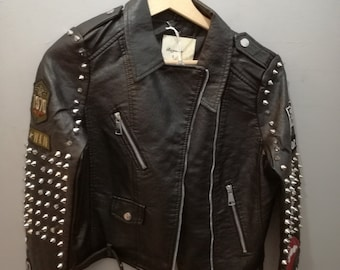 Leather nail with studs and patches