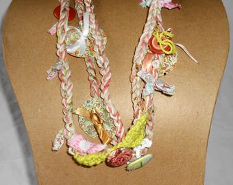 Textile necklace in pink, green and beige