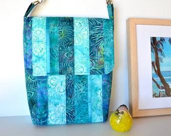 Blue cross body bag with batik patchwork, aqua and turquoise ocean coloured satchel
