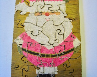 Mid Century handmade jigsaw puzzle. Decoupage santa on wood. Cute neon pink kitsch Christmas puzzle toy decor