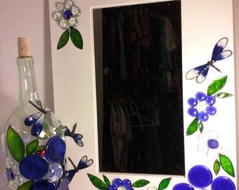 Mirror that matches bottle.