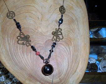 Watch black ball quartz mounted as a necklace... Black quartz watch with a long necklace.