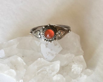 red stone sterling ring with hearts, size 6.75