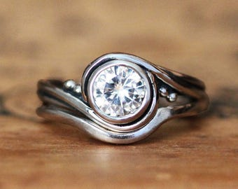 Handmade engagement and wedding rings in by StephanieMaslow