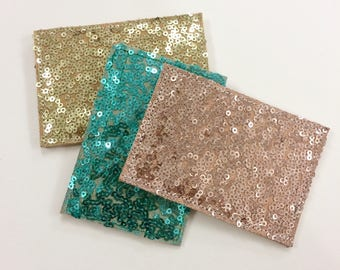genuine leather cardholder.  Sparkling sequins
