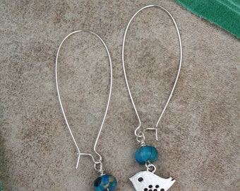 5  Turquoise howlite stones and silver bird dangle earrings with sterling silver ear wires