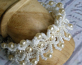 Pearl bracelet cuff in micro macrame with vintage pearls. Handmade wedding jewelry.