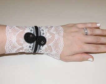 Adjustable bracelet cuff black with white lace and zipper flowers