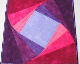 Purple swirl fabric plate mat