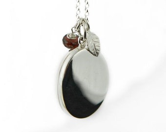 Large plain silver locket with birthstone and leaf charm