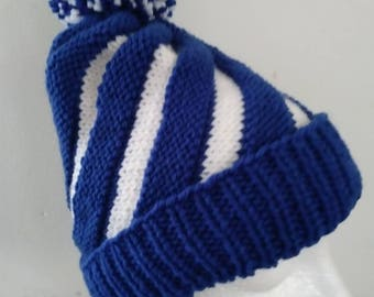 Hand Knitted Children Swirl hat with pompom, fits age 2-3. Royal blue and white