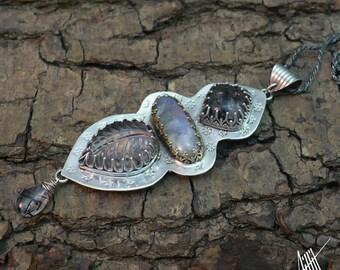 "Sterling silver , winter pendant ""Hiemsa"" with black rutile quartz, moonstone and quartz."