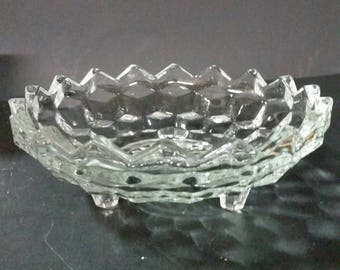 Vintage clear glass 3 footed open candy dish.  Dimond or cube pattern