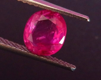 0.98 Ct. I.G.I. Certified unheated Ruby. Antique and vintage neon pinkish red classic round Ruby from the legendary mine