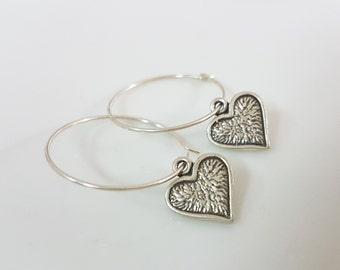 Heart hoop earrings, Silver heart earrings, Silver hoop earrings with dangling heart charm