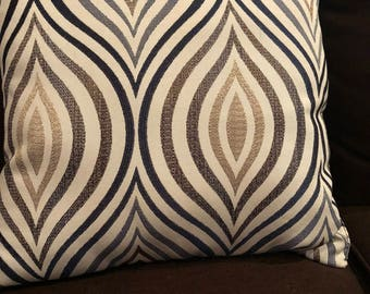 Brown,cream and navy blue printed pillow