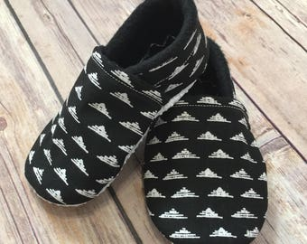 Black and white moccasin booties