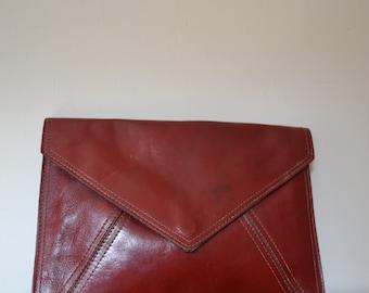 Vintage 70s deep red leather envelope clutch bag