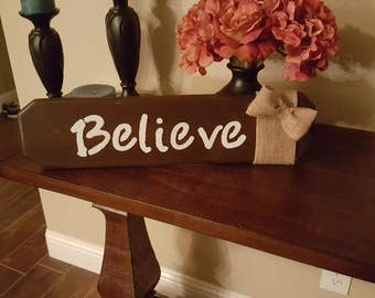Believe wood stained sign with burlap bow