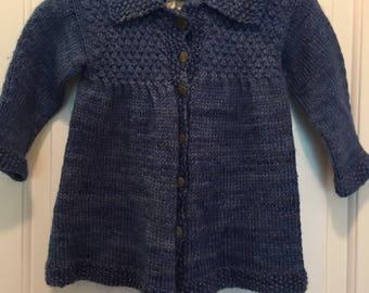 Handknit girls jacket smocked