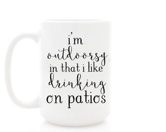 """Ceramic Mug, """"I'm Outdoorsy In That I Like Drinking On Patios"""". Funny Coffee Mugs with Quotes, by Milk & Honey."""