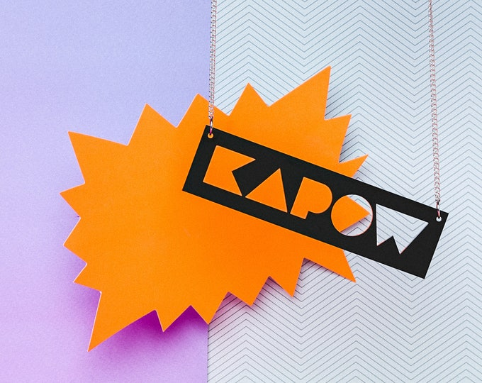 Pop art inspired typographic black acrylic KAPOW statement necklace