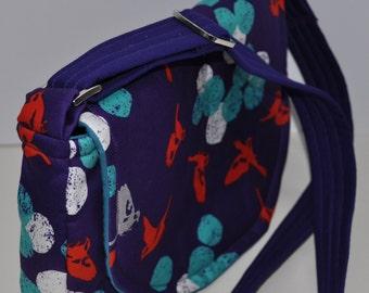 Purple fabric handbag