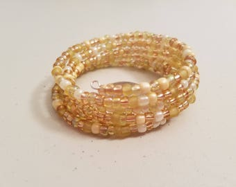 Gold and cream coil bracelet