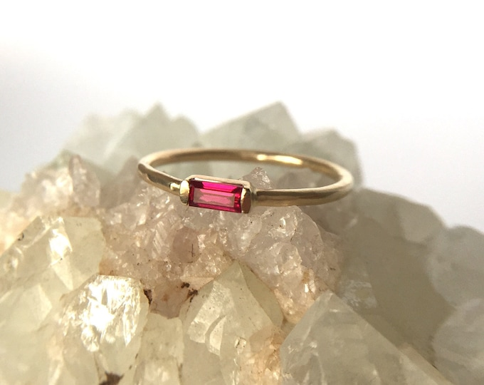 ruby baguette ring in gold